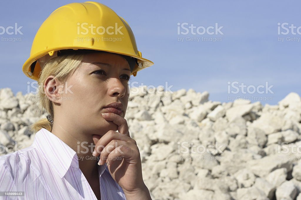 Woman in hard hat working on site. royalty-free stock photo