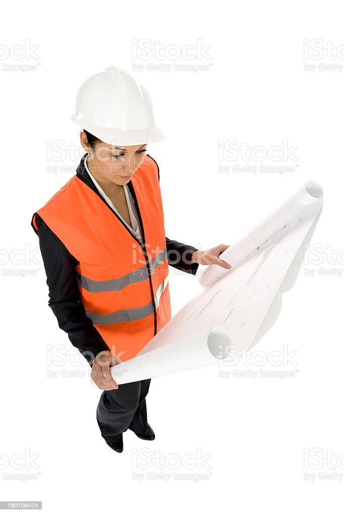 Woman in hardhat, holding blueprints royalty-free stock photo