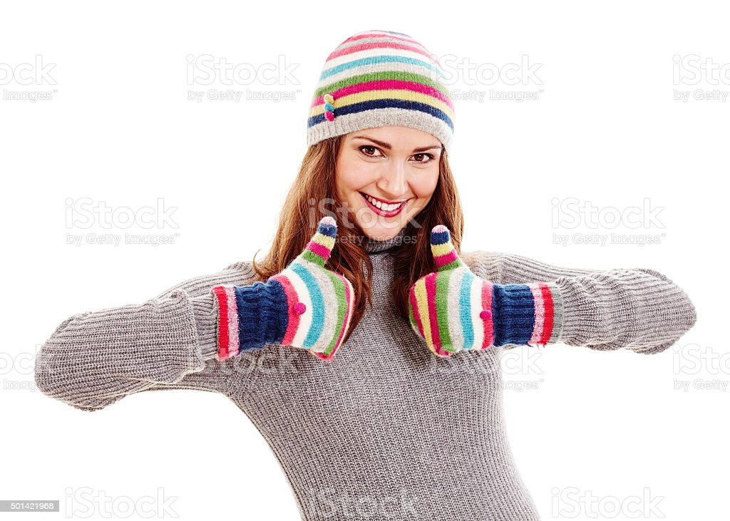 Woman in hat and mittens stock photo