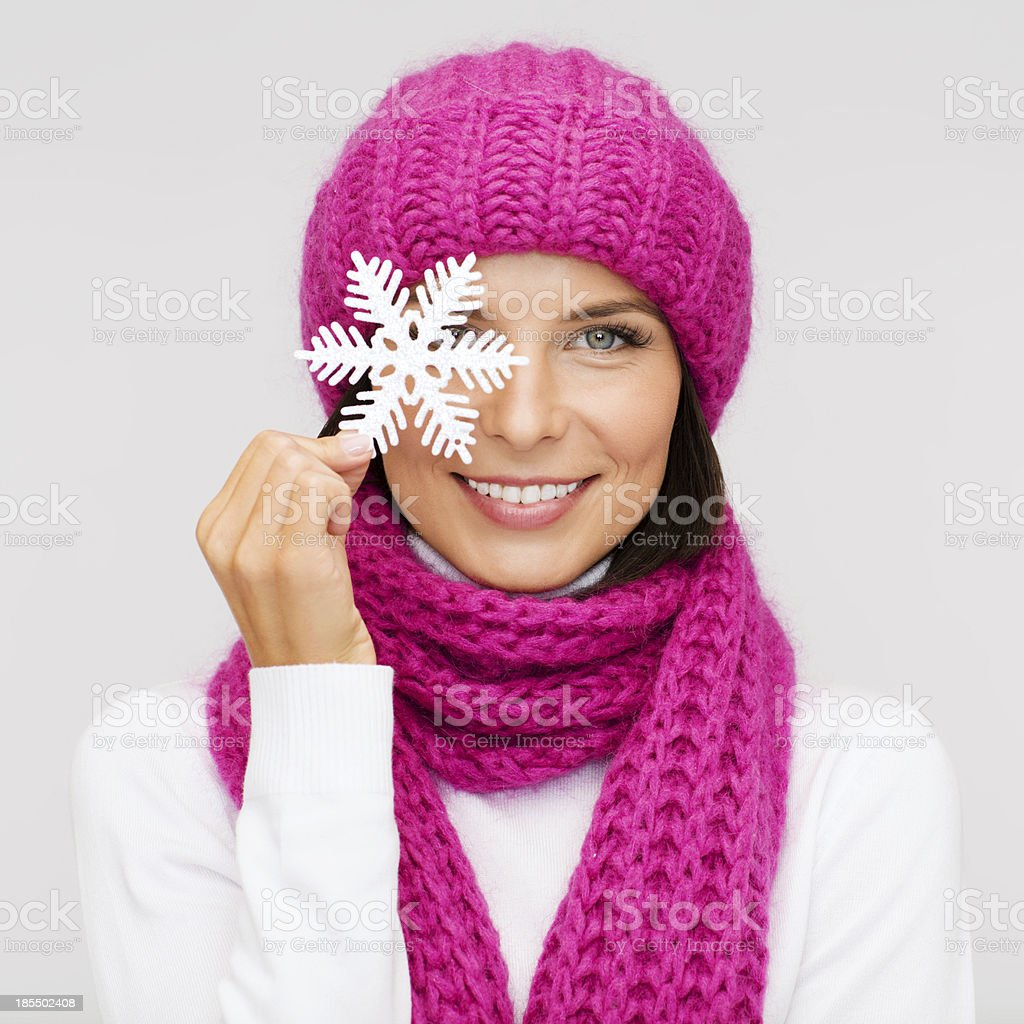 woman in hat and muffler with big snowflake royalty-free stock photo