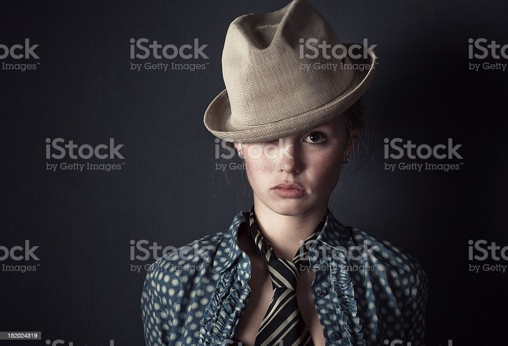 Woman in hat and tie portrait royalty-free stock photo