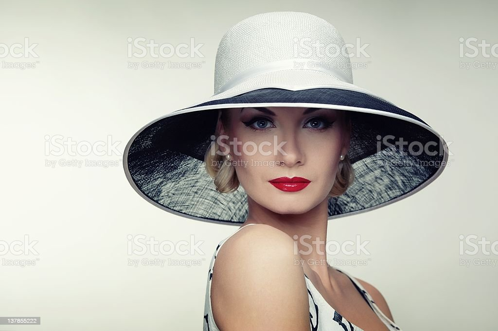 Woman in hat retro portrait. stock photo