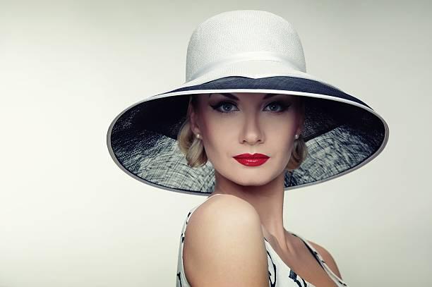 Woman in hat retro portrait. stock photo
