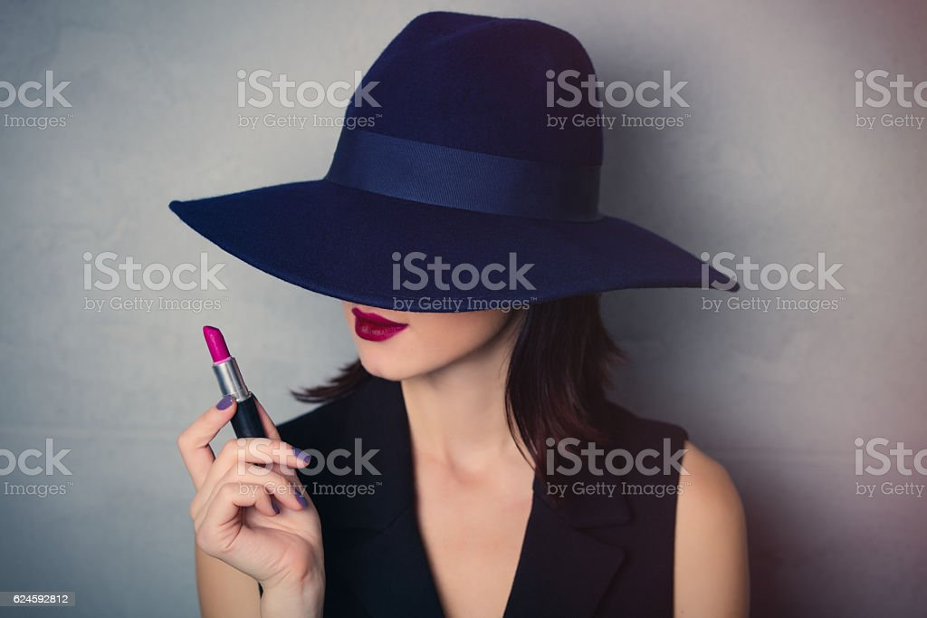 woman in hat with lipstick stock photo