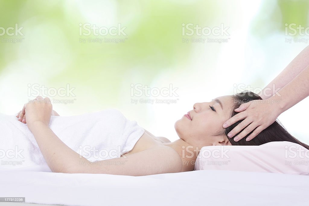 woman in health spa with green background royalty-free stock photo