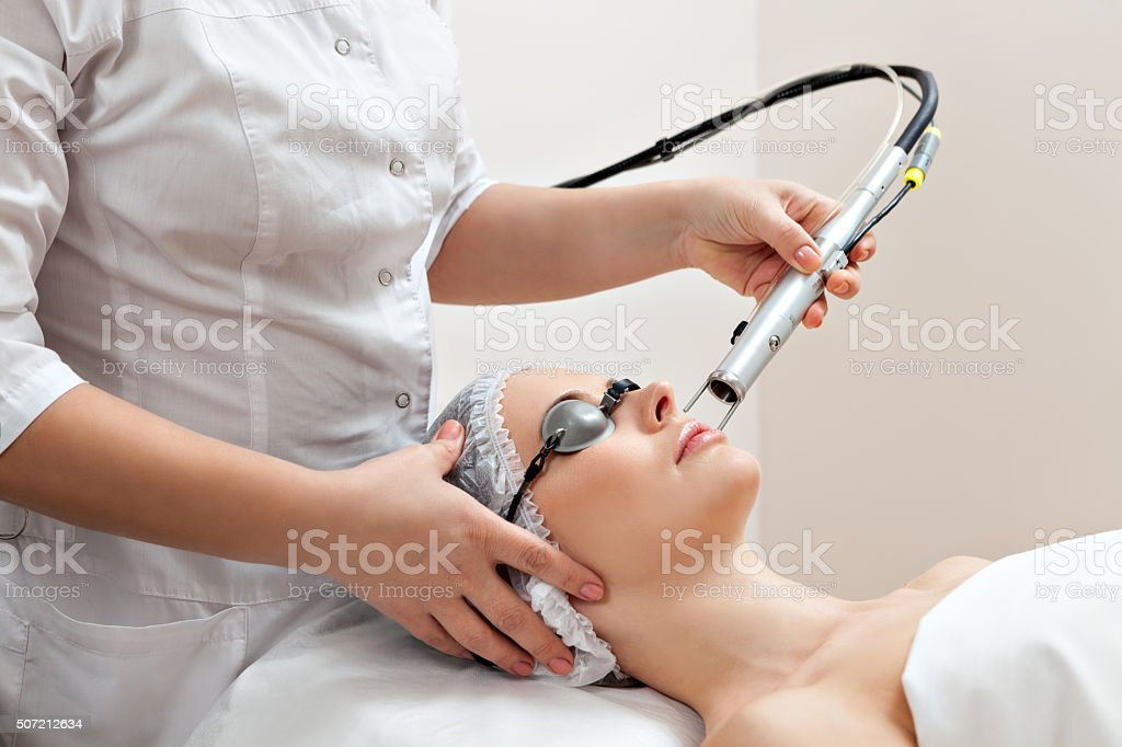 Woman in healthy spa salon stock photo