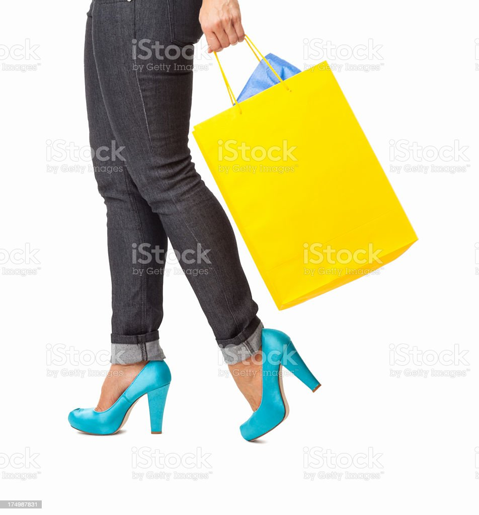 Woman In Heels With Shopping Bag - Isolated stock photo