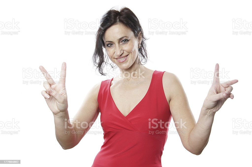 woman in her forties making peace or victory hand sign stock photo