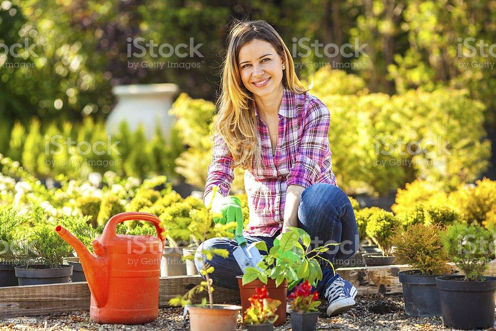 Woman in her garden. stock photo