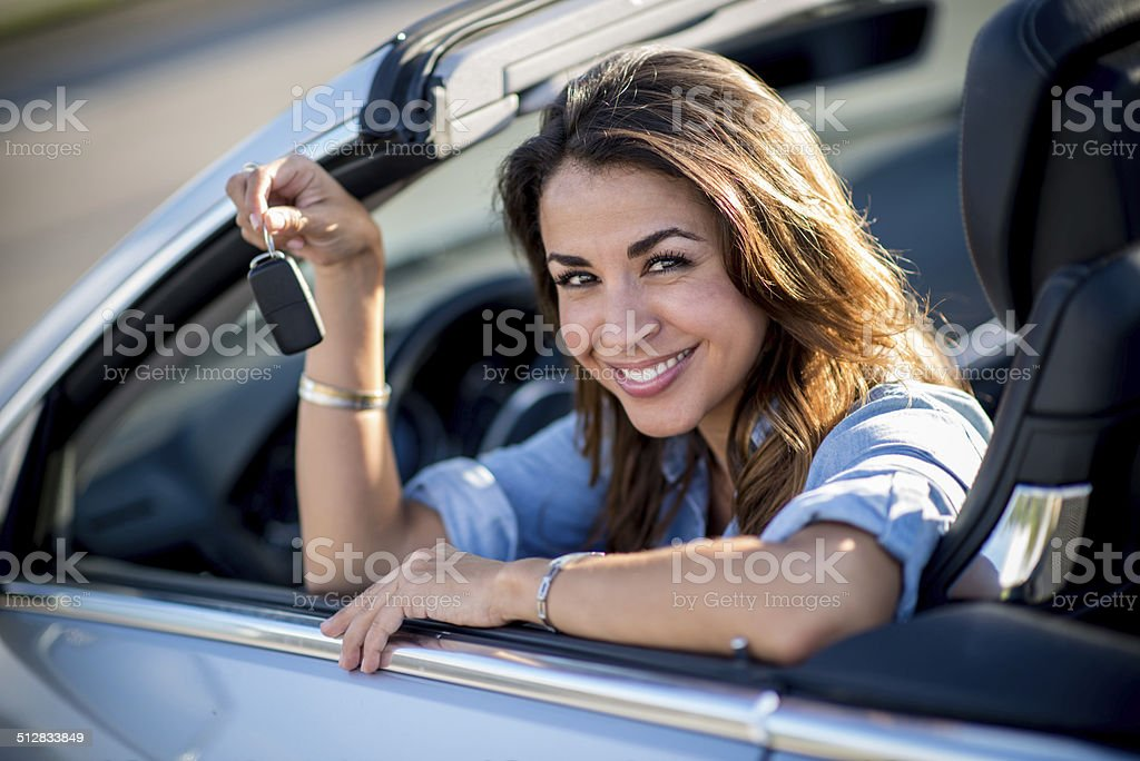 Woman in her new car stock photo