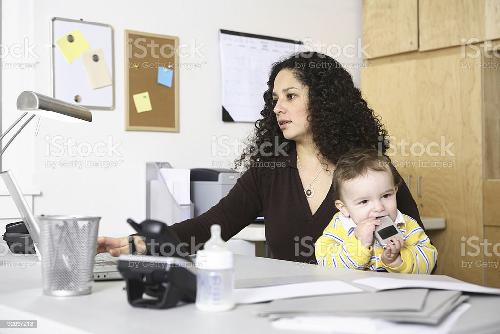 Woman in home office with child royalty-free stock photo