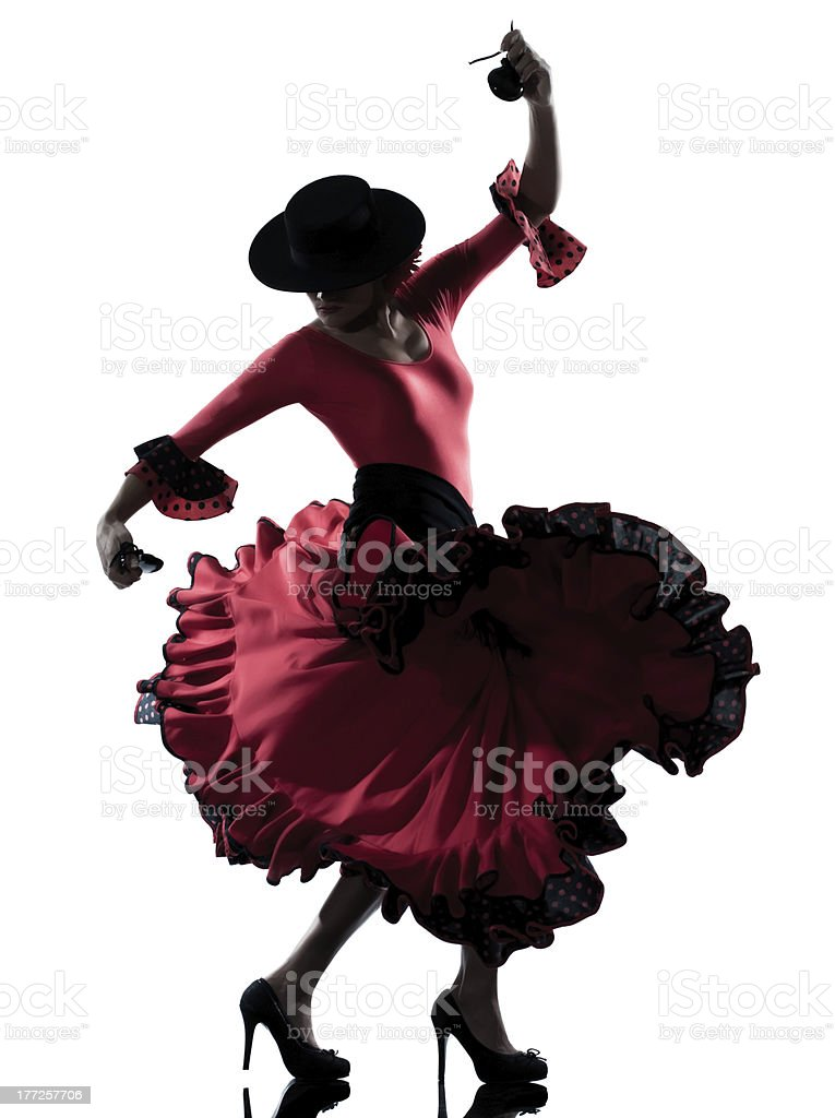 Woman in hot pink gipsy dress dancing the flamenco stock photo