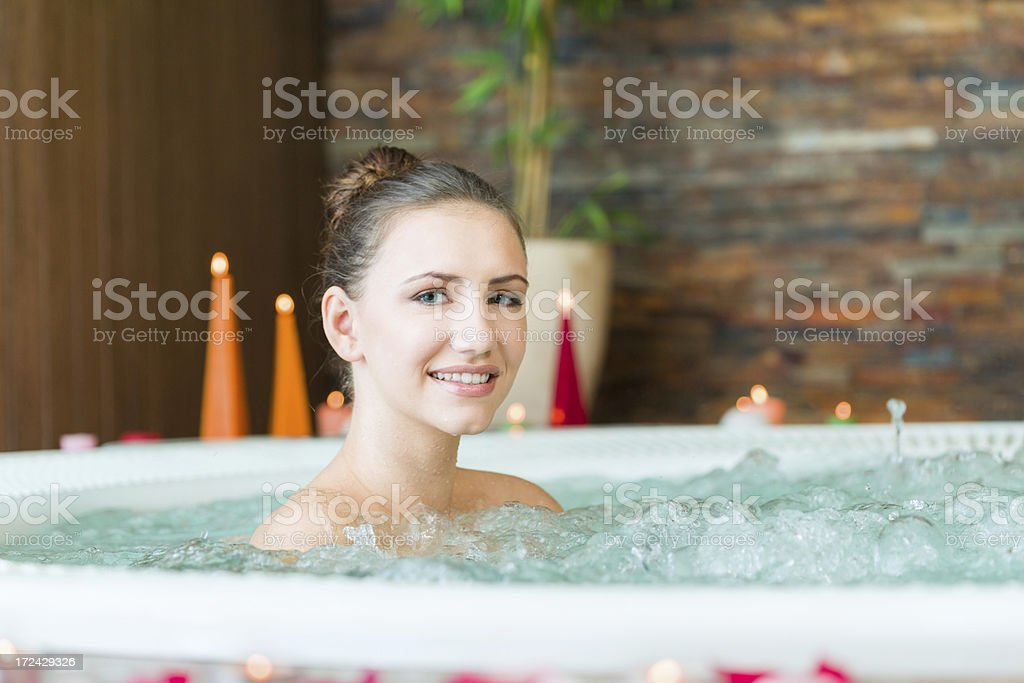 Woman in jacuzzi royalty-free stock photo