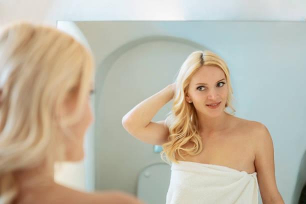 Woman in hotel bathroom stock photo