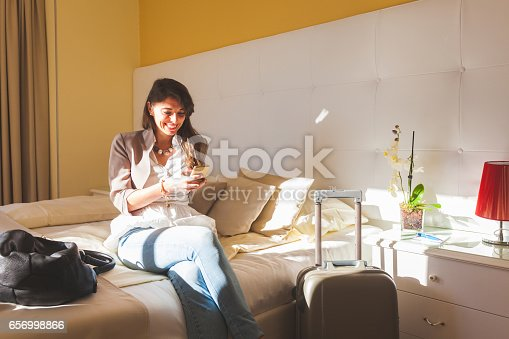 istock Woman in Hotel Bedroom 656998866