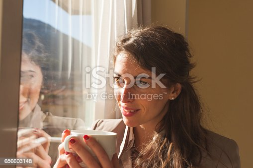 istock Woman in Hotel Room Having a cup of Tea 656603148
