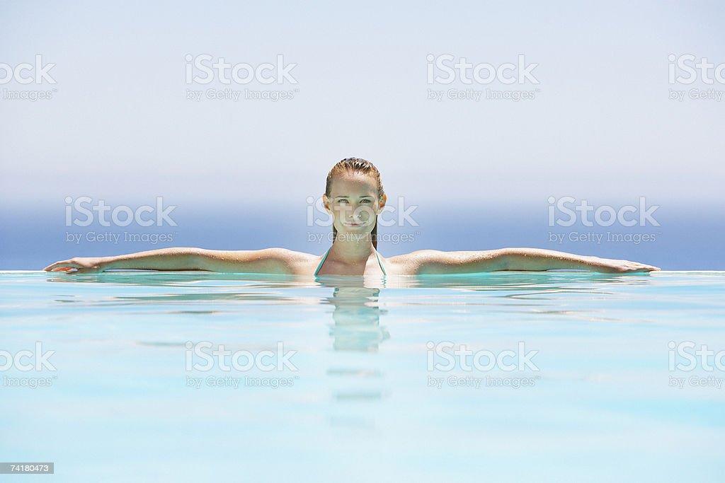 Woman in infinity pool stock photo