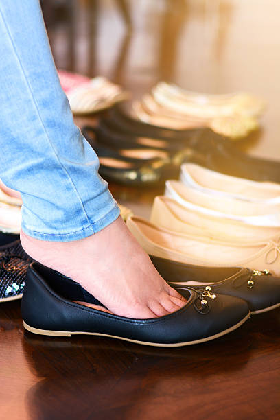 woman in jeans and black shoes stock photo