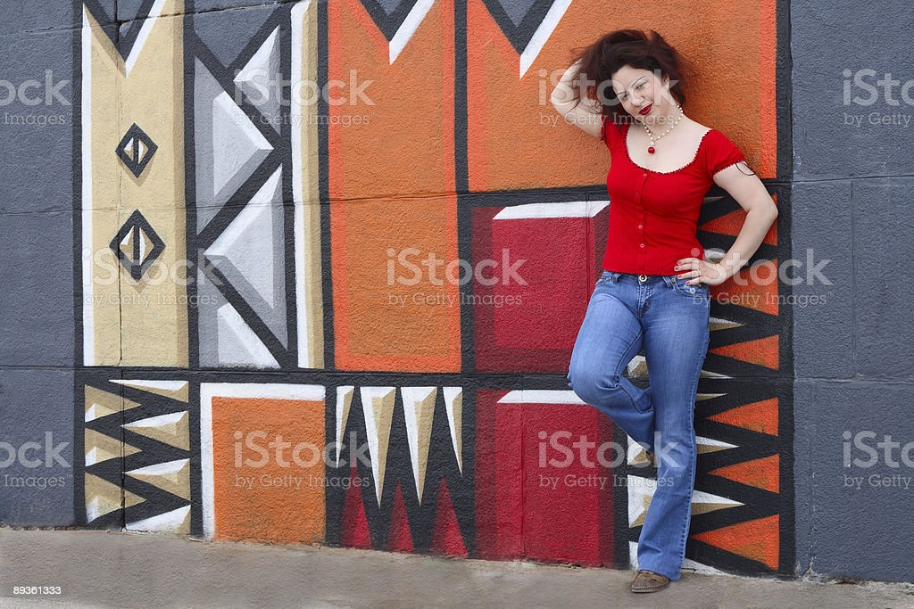 Woman in jeans and red shirt royaltyfri bildbanksbilder