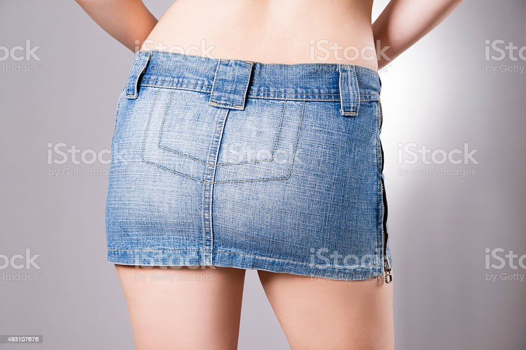 Woman in jeans skirt closeup stock photo