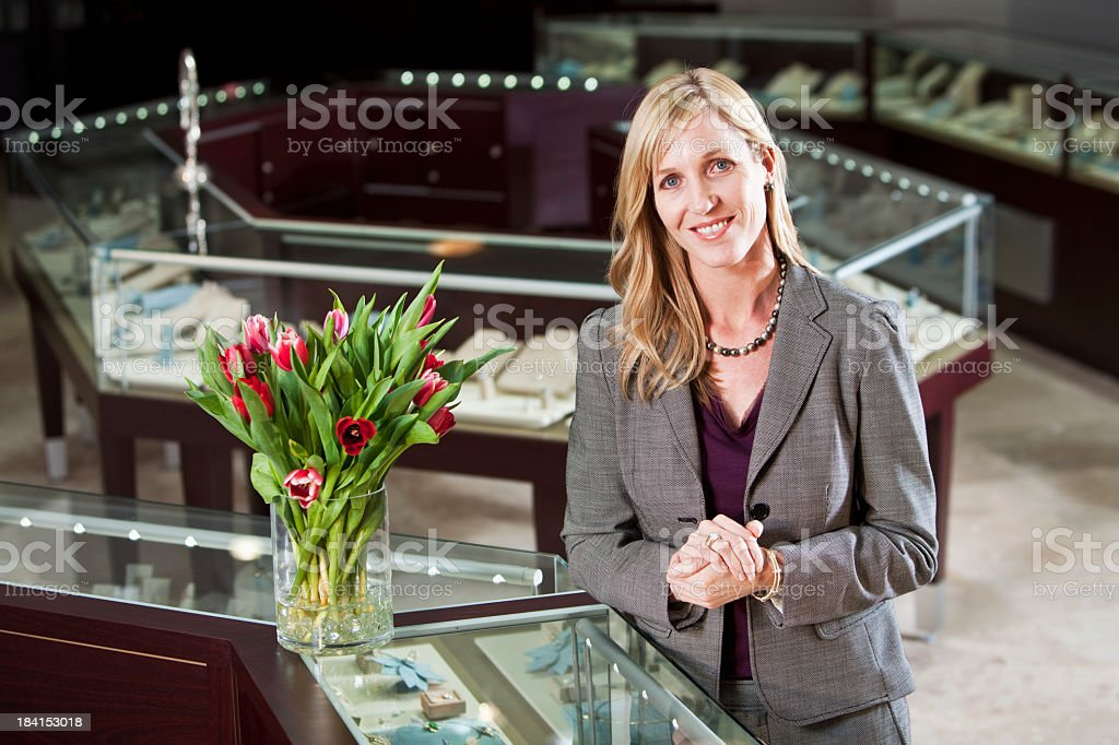 Woman in jewelry store stock photo