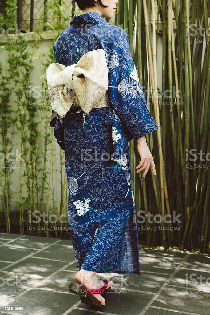 Woman in kimono and geta shoes stock photo