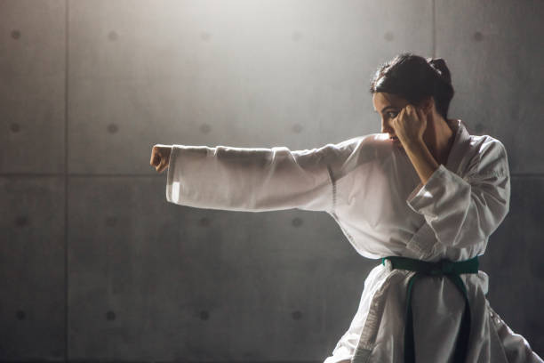 woman in kimono practicing karate - karate stock photos and pictures