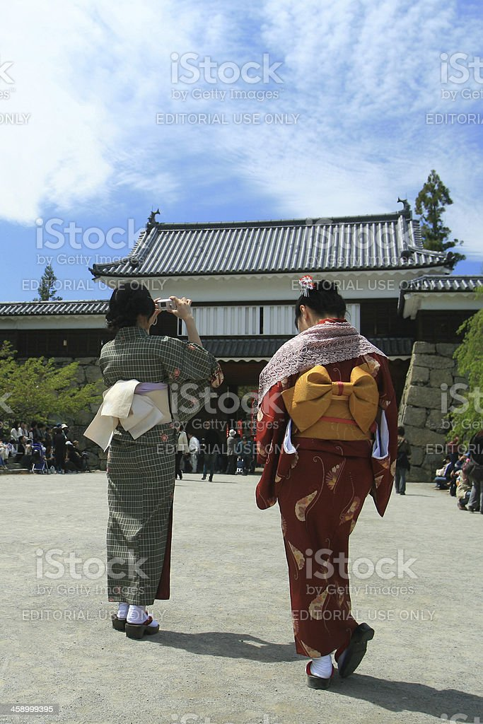 Woman in kimono taking a photo stock photo