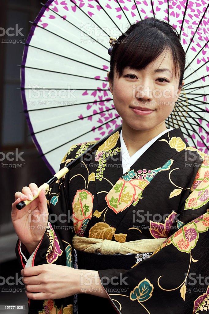 Woman in kimono with umbrella royalty-free stock photo