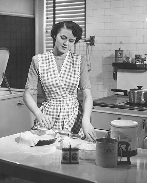 Woman in kitchen making pie (B&W)  cooking black and white stock pictures, royalty-free photos & images