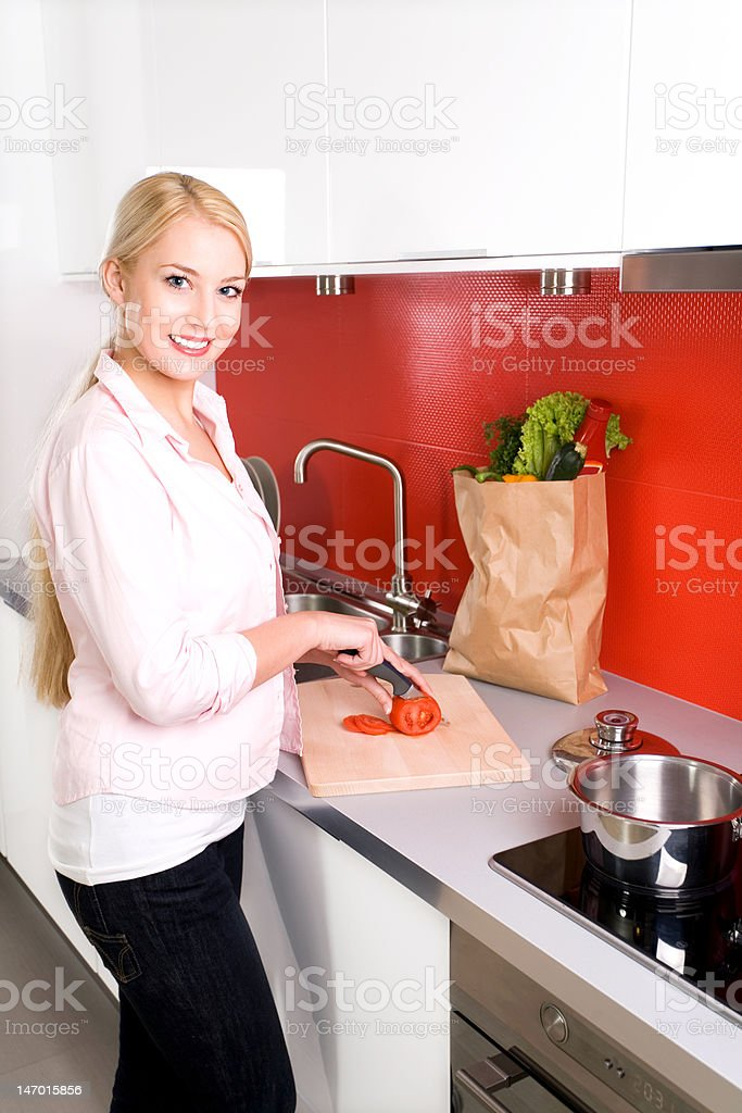 Woman in kitchen preparing food royalty-free stock photo