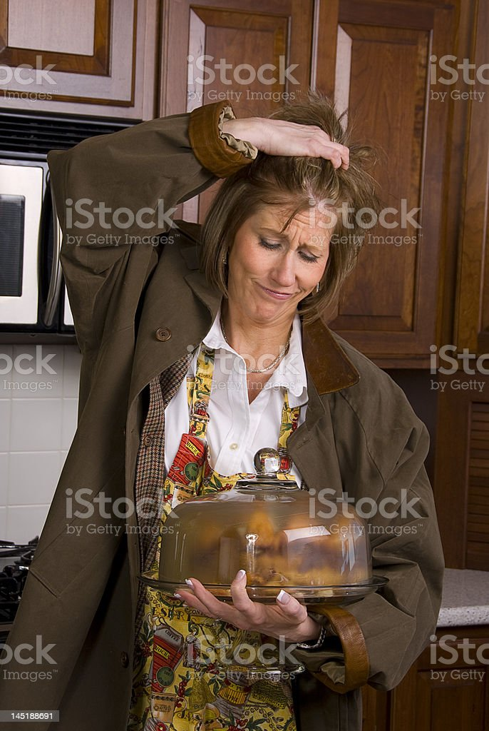 Woman in kitchen with cake royalty-free stock photo
