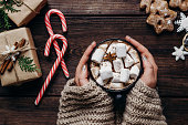 istock woman in knitted sweater with mug of hot chocolate 1053704042