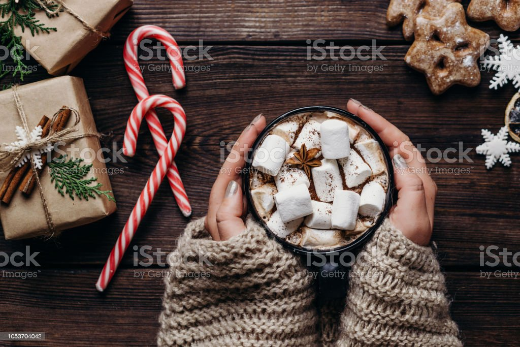 woman in knitted sweater with mug of hot chocolate stock photo