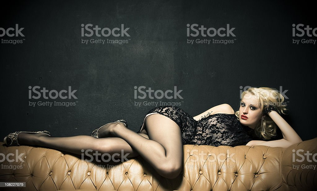 Woman in Lace Lying on Couch and Posing stock photo