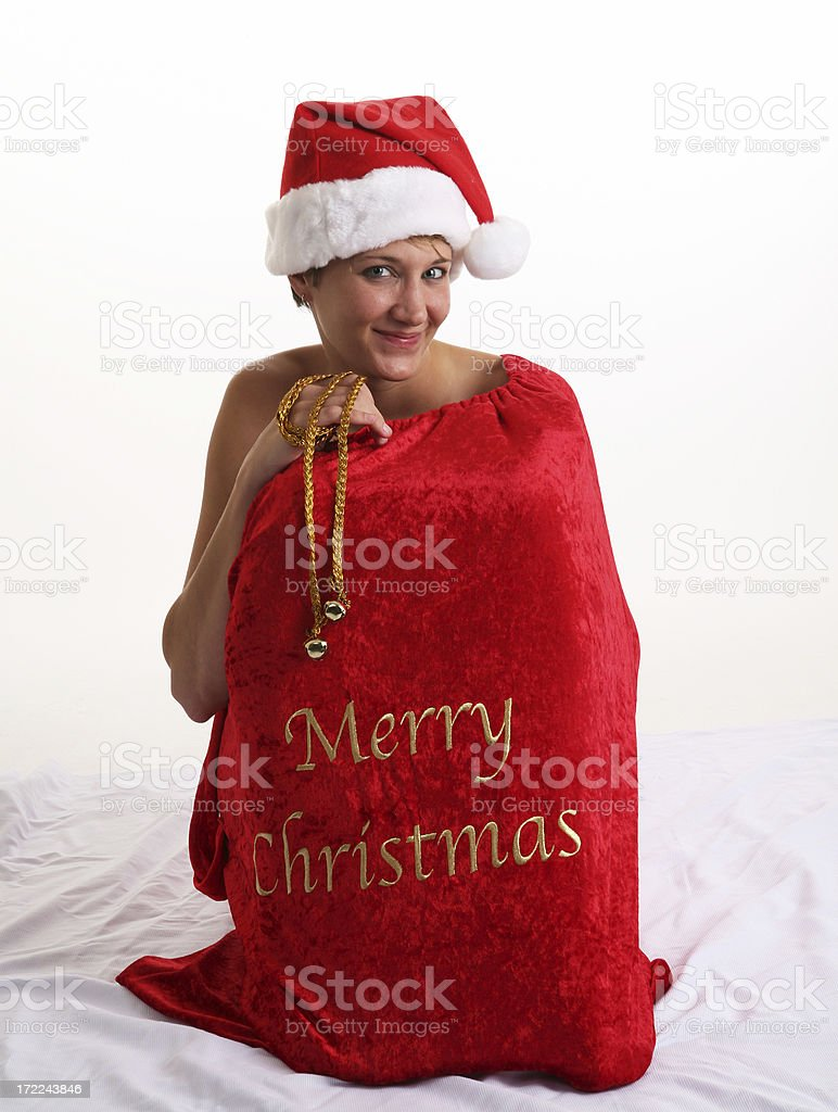 Woman in Large Christmas Sack stock photo