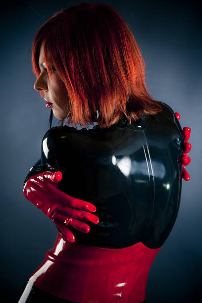 woman in latex catsuit woman in latex fetish clothing hot sexy butts stock pictures, royalty-free photos & images