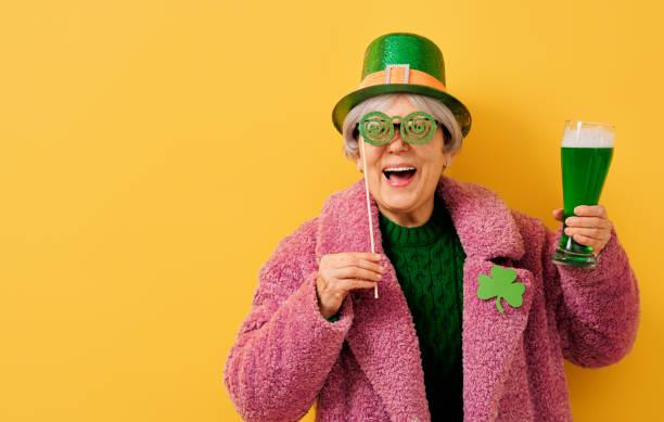 woman in leprechaun hat stock photo