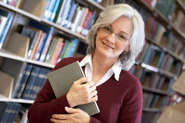 Woman in Library Series (XXL)  medium length hair stock pictures, royalty-free photos & images