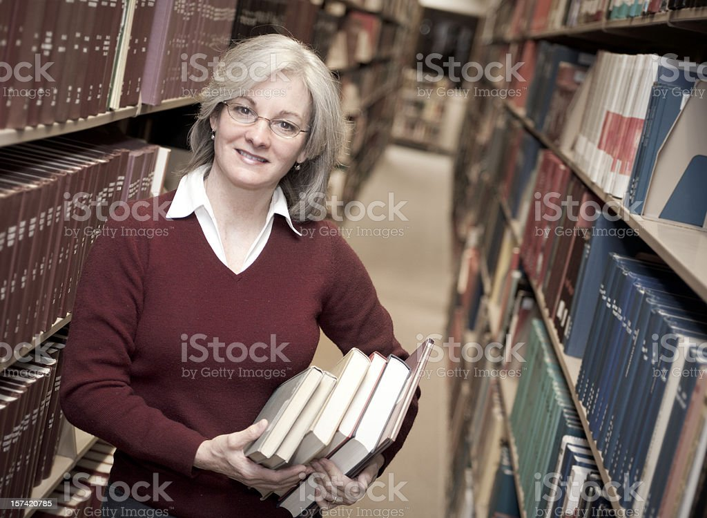 Woman in Library Series royalty-free stock photo