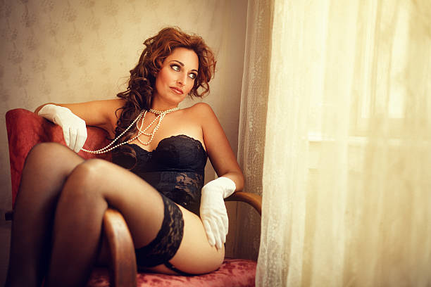 woman in lingerie by the window - black women wearing pantyhose stock photos and pictures
