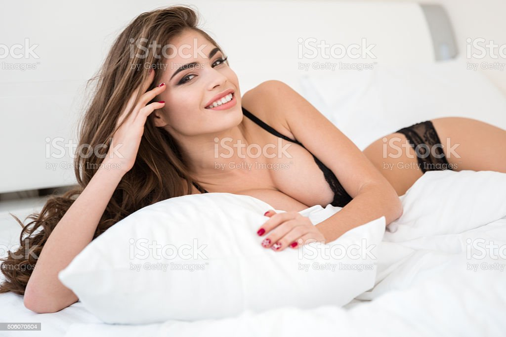 Woman in lingerie lying on the bed​​​ foto