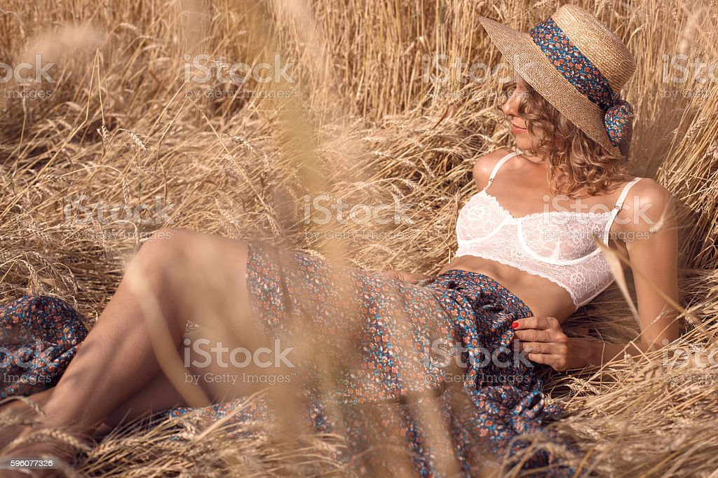 Woman in lingerie posing in a wheat field. royalty-free stock photo