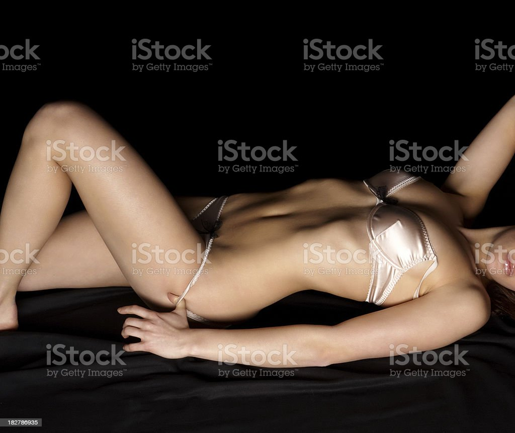 woman in lingerie undressing her panties royalty-free stock photo