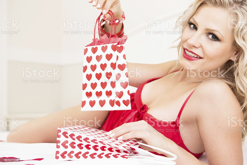 Woman in lingerie with Valentine's Day Gift bag royalty-free stock photo