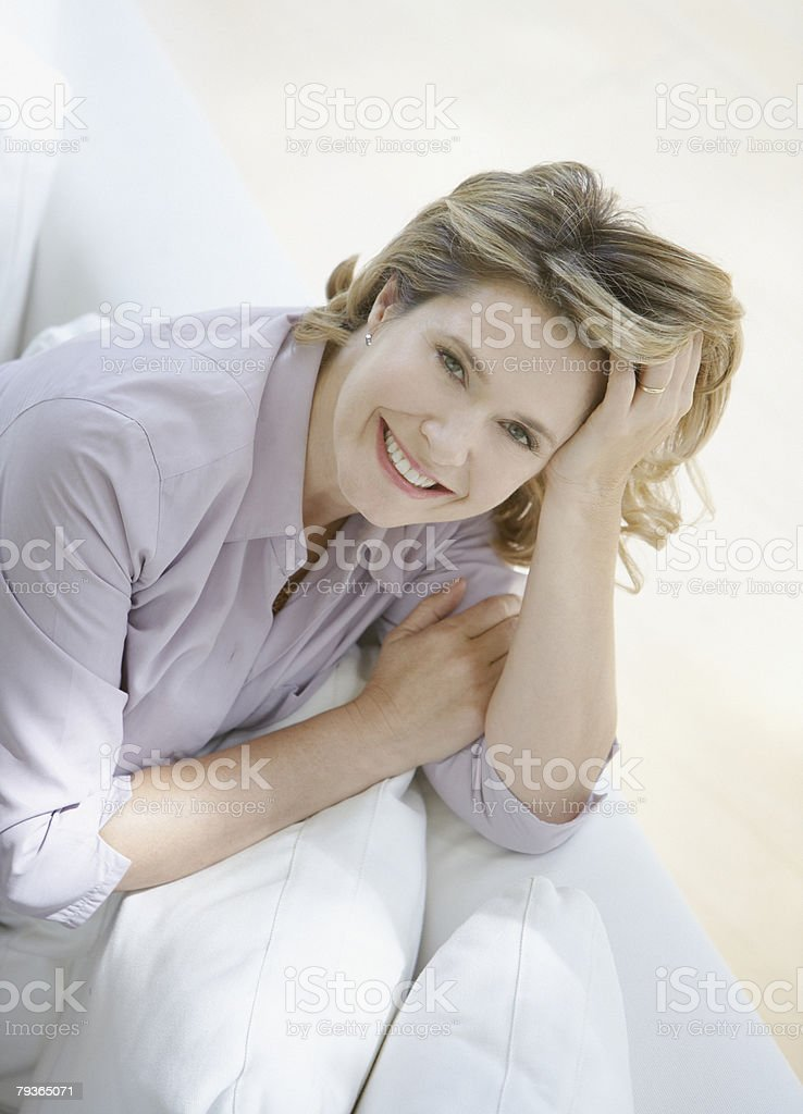 Woman in living room on sofa 免版稅 stock photo