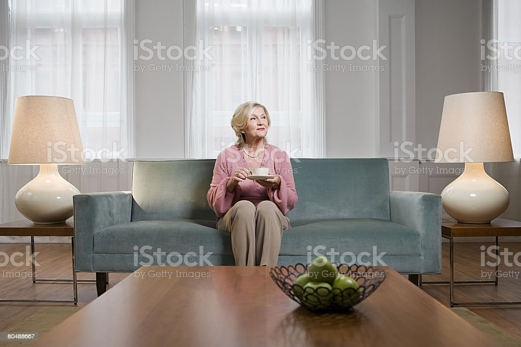 Woman in living room stock photo