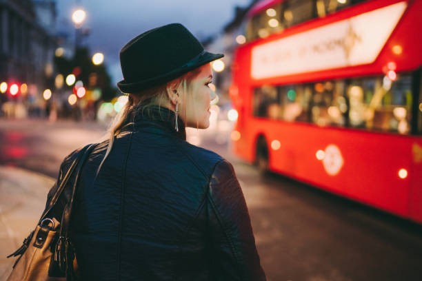 Woman in London Woman in London waiting at the bus stop central london stock pictures, royalty-free photos & images