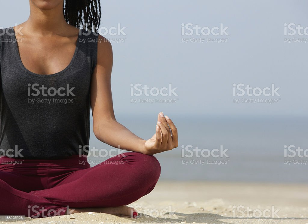 Woman in lotus position stock photo