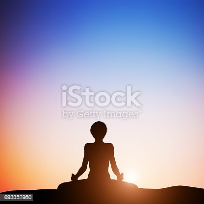 Woman in lotus yoga pose meditating at sunset. Zen, meditation, peace
